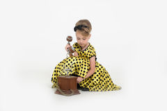 Little girl in a yellow dress Stock Photography