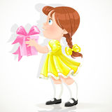 Little girl in a yellow dress gives a gift Royalty Free Stock Image