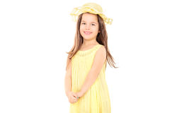 Little girl in yellow dress looking at camera Stock Image