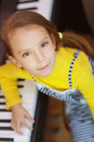 Little girl in yellow dress plays Royalty Free Stock Photography