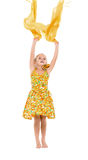Little Girl in a Yellow Dress throws up Shawl Stock Photo