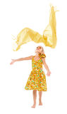 Little Girl in a Yellow Dress throws up Shawl Royalty Free Stock Photo