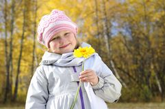 Little girl with a yellow flower Royalty Free Stock Images