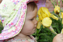 Little girl with yellow flower Royalty Free Stock Photos
