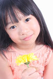 Little girl with yellow flower Stock Image