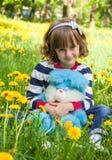 Little girl among yellow flowers Stock Photo
