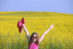 Little girl on yellow flowers field summer season Royalty Free Stock Photography