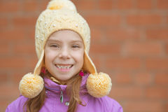 Little girl in yellow hat and pink jacket Royalty Free Stock Photo