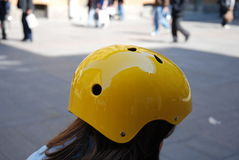 Little girl in a yellow helmet Royalty Free Stock Photo