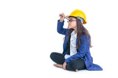 Little girl with a yellow helmet  writing with pen Royalty Free Stock Image