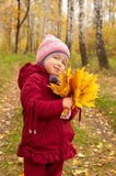 Little girl with yellow leaves Royalty Free Stock Photos