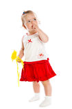 Little girl with yellow magic wand Royalty Free Stock Photos