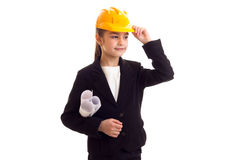 Little girl in yellow protective helmet Stock Images