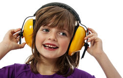 Little girl with yellow receiver Royalty Free Stock Photos