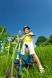 Little girl in yellow shirt on a bike Stock Image