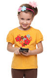 Little girl in a yellow shirt with smartphone Stock Photography