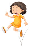 Little girl in yellow skirt jumping Royalty Free Stock Photography