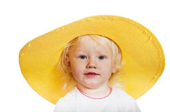 little girl in a yellow straw hat Royalty Free Stock Image