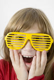 little girl in yellow sun glasses Royalty Free Stock Photography