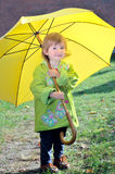 The little girl with a yellow umbrella Royalty Free Stock Images