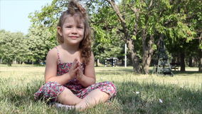 Little girl yoga meditation stock video footage