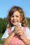 Little girl with yoghurt small bottle Royalty Free Stock Photography