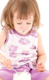 Little girl with yogurt Stock Photos