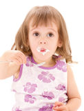 Little girl with yogurt Royalty Free Stock Image