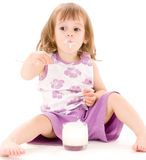Little girl with yogurt Royalty Free Stock Photography