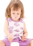 Little girl with yogurt Stock Photos