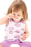 Little girl with yogurt Royalty Free Stock Photo