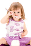 Little girl with yogurt Stock Images