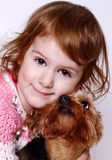 Little girl and  Yorkshire Terrier Stock Images