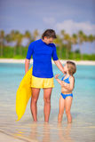 Little girl and young father with air mattress on stock photo