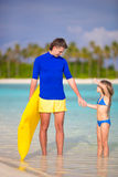 Little girl and young father with air mattress on Royalty Free Stock Photos