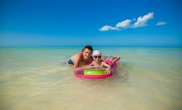 Little girl with young father on an air mattress Stock Images