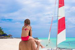 Little girl and young father during tropical beach Royalty Free Stock Images