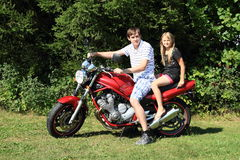 Little girl and young man on motorbike Stock Photography