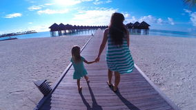Little girl and young mom during beach vacation stock footage
