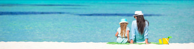 Little girl and young mom relaxing at beach Royalty Free Stock Photography