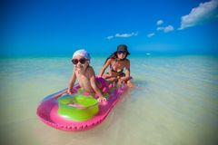 Little girl with young mother on an air mattress Royalty Free Stock Images