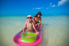 Little girl with young mother on an air mattress Royalty Free Stock Photo