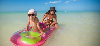 Little girl with young mother on an air mattress Stock Photos