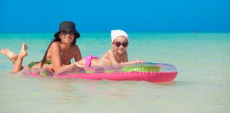Little girl with young mother on an air mattress Stock Photography
