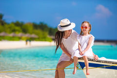 Little girl and young mother during beach vacation Royalty Free Stock Photos