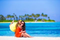 Little girl and young mother during beach vacation Royalty Free Stock Image