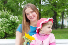 Little girl and young mother in a park Royalty Free Stock Images