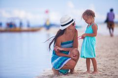 Little girl and young mother on tropical beach Royalty Free Stock Images