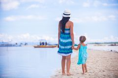 Little girl and young mother on tropical beach Royalty Free Stock Photography