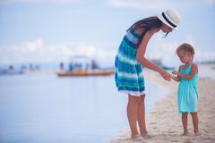 Little girl and young mother on tropical beach Stock Photography
